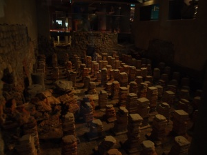 the stacked tiles were used by the Romans to allow steam heat to flow and heat the floors of the complex