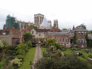 a view of the minster and some lovely English gardens from the wall