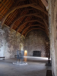 The Great Hall, complete with central hearth fire basket.