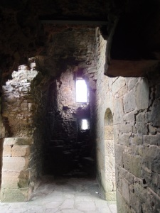 back down the hallway towards the dungeon cell